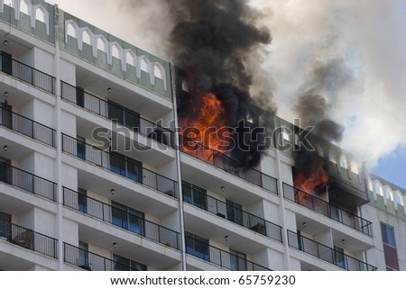 High-rise condominium or apartment burning. - stock photo