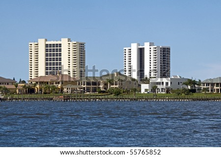 High Rise condominiums and luxury homes on South Daytona intercoastal waterway - stock photo