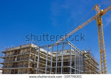 High rise construction and crane - stock photo