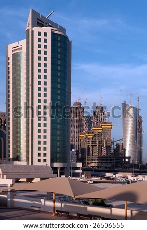 High-rise construction under way in the Gulf Arab state of Qatar, March 2009, despite the global financial crisis. Logos have been removed - stock photo