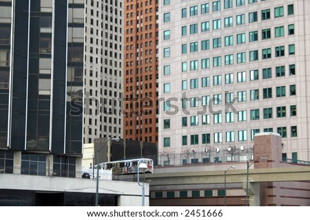 High rise historic buildings and people mover in downtown Detroit - stock photo