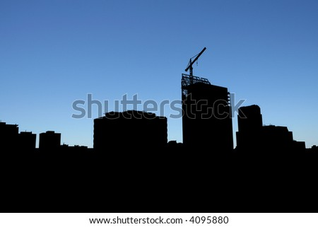 High-rise office building under construction - Silhouette - stock photo