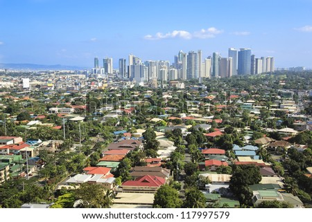 high rise offices of fort bonifacio business district in makati city centre of manila in the philippines - stock photo