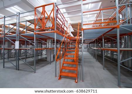 Mezzanine Shelves. The Metal Staircase On The Mezzanine
