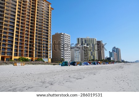 high rise resort condos on beach - stock photo