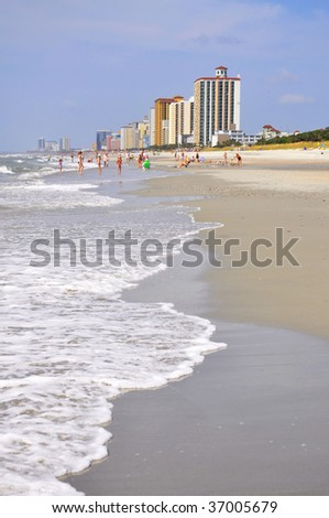 high rise resort condos on beach - stock photo