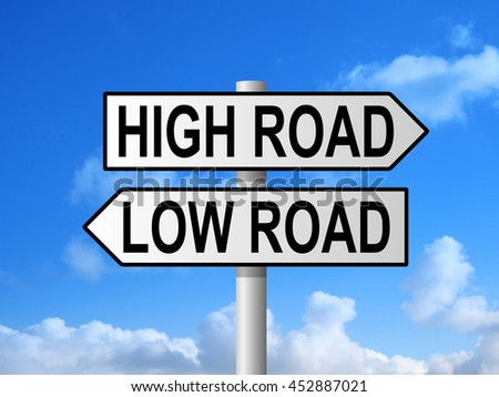 High road and low road sign post against blue sky - stock photo