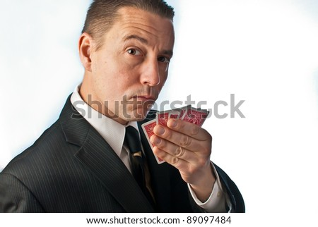 high roller mand playing poker - stock photo
