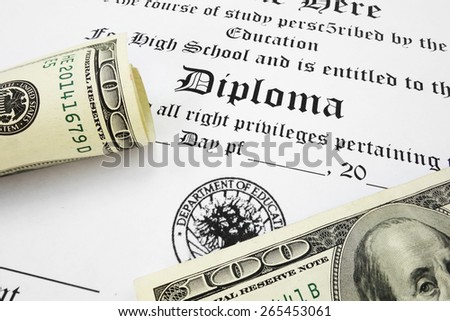 High school diploma and cash                                - stock photo