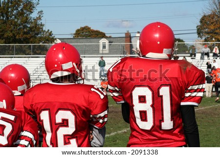 High School Football Team on Sidelines - stock photo