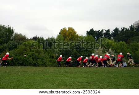 high school footballs, QB about to catch ball - stock photo