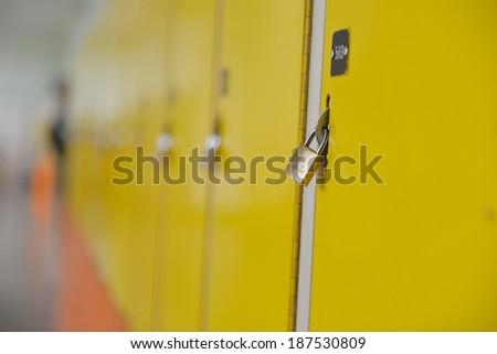 High School hallway showing yellow student lockers - stock photo