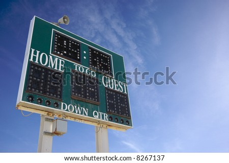 HIgh School Score Board on a Blue Sky - stock photo