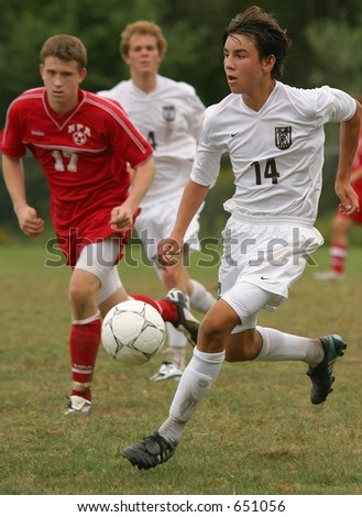 High school soccer players. Editorial use only. - stock photo