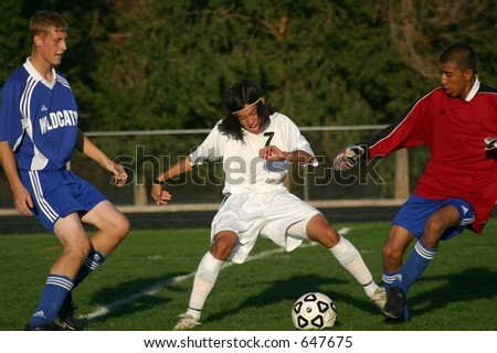 High school soccer players vying for the ball.  (Editorial use only) - stock photo