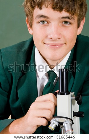 high school student use microscope - stock photo