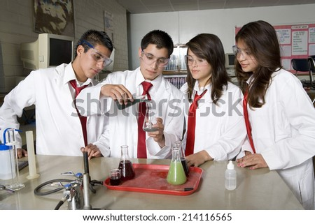 High School Students Conducting Science Experiment - stock photo