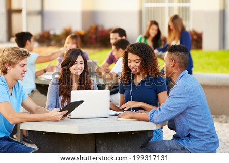 High School Students Hanging Out On Campus - stock photo