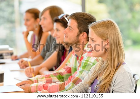 High-school students listening to lesson in class campus college teens - stock photo