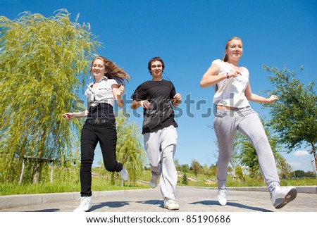 High school students running in park - stock photo