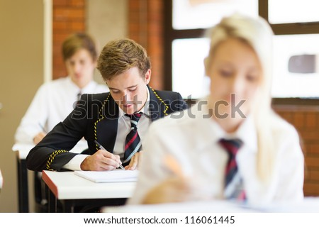 high school students sitting in classroom - stock photo