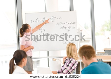 High school students with professor in classroom studying - stock photo