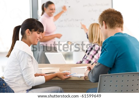 High school students with professor in classroom studying