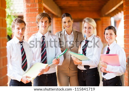 high school teacher and students portrait - stock photo