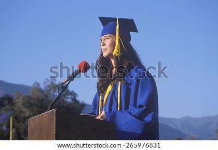 High school valedictorian giving her commencement speech, Ojai, CA - stock photo
