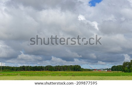 High sky over rural fields - stock photo
