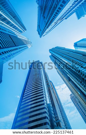 High skyscrapers of Dubai blue-toned - stock photo