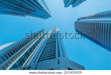 High skyscrapers of Dubai blue-toned - stock photo