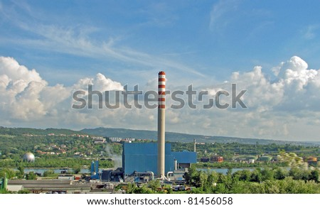 high smokestack of an incinerator for municipal waste