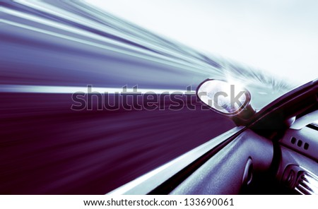 High-speed car concept in blue toned - stock photo