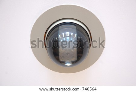 High speed CCTV security camera on wall - stock photo