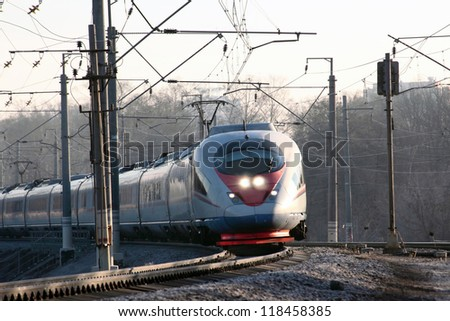 High-speed commuter train on railway - stock photo