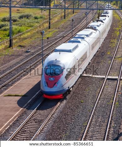 High-speed commuter train on railway - stock photo