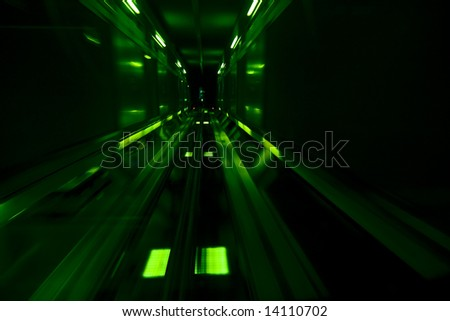 High speed in underground, green toned. - stock photo