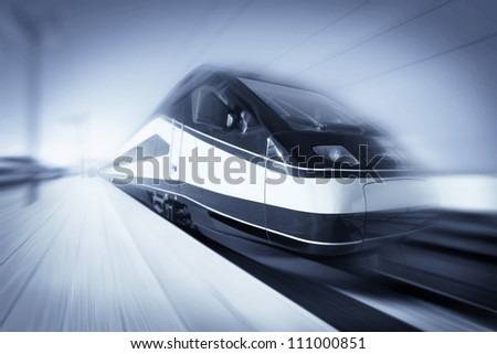 High-speed modern intercity train with motion blur, abstract - stock photo