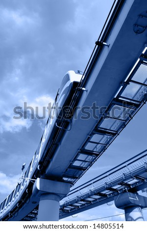 High speed monorail train on overpass toned in blue color - stock photo