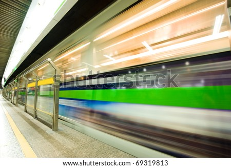 high speed moving train in subway station. - stock photo
