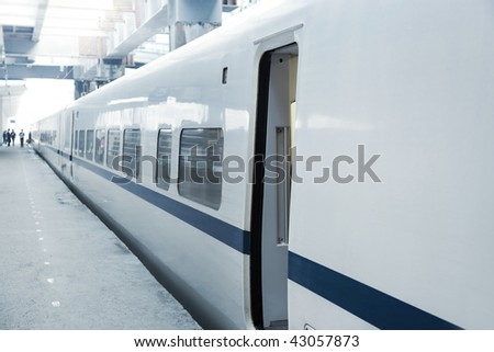 High-speed  MU(Multiple Unit) train on platform with opening door waiting for people get on in China - stock photo
