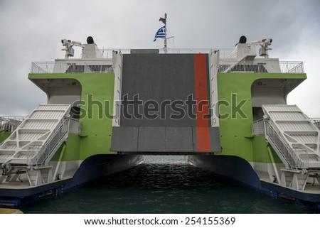 High speed passenger and cargo catamaran - stock photo