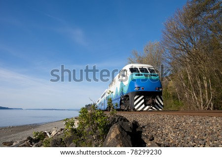 High-speed passenger train on a background of blue sky. - stock photo