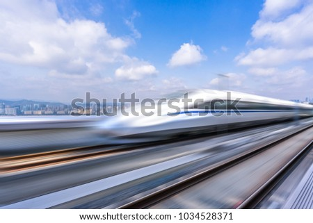 high speed railway with cityscape and modern office building in urban