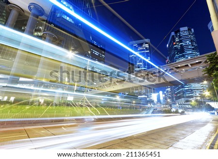 High speed traffic and blurred light trails under the overpass at night scene  - stock photo