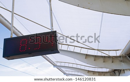 High-speed train and the platform and schedule - stock photo