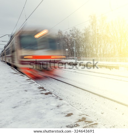 High-speed train arrives to the station at winter evening time. - stock photo