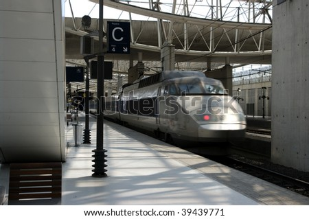High speed train arriving at a Parisien train station - stock photo