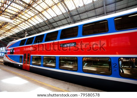 high speed train at a railway station - stock photo